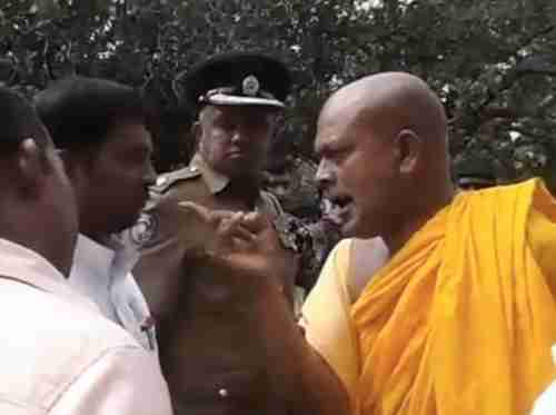 Image grab from video shows Buddhist monk using racist language to a Hindu Tamil civil servant, while policeman looks on and does nothing