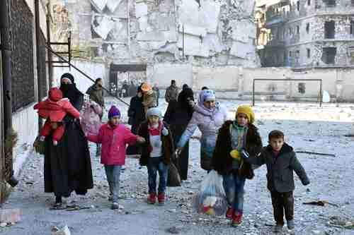 A family of Sunni 'terrorists' flee the fighting in Aleppo (Reuters)