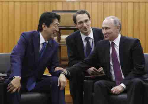 Shinzo Abe and Vladimir Putin at their meeting on Friday (AP)