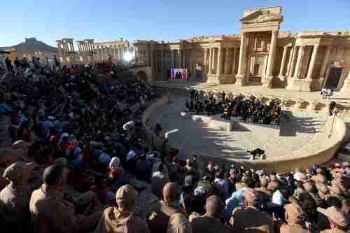 Russia holds a concert on 5-May to celebrate the recapture of Palmyra from ISIS. Note that Vladimir Putin is on the wide-screen tv on the left side of the stage (AFP)