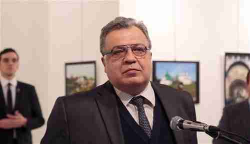 Andrey Karlov giving his speech in an Ankara art museum, just before being shot. In the left rear is the assassin, Mevlüt Mert Altintas. (Hurriyet)