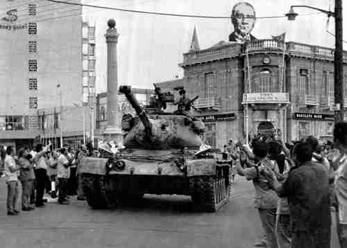A Turkish army tank passes through the Turkish section of Nicosia in 1974. (AP)