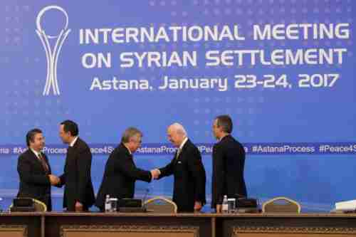 Politicians shake hands and congratulate each other at Tuesday's conclusion of the Syria peace negotiations (AP)
