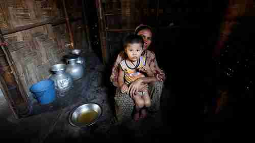 A Rohingya woman and child in a refugee camp in Bangladesh (Reuters)