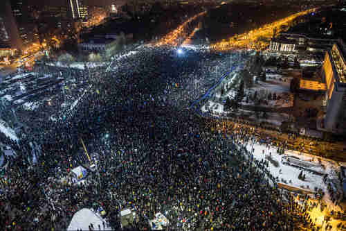 Around 150,000 people protested in Romania's capital city Bucharest on Wednesday (Al Jazeera)