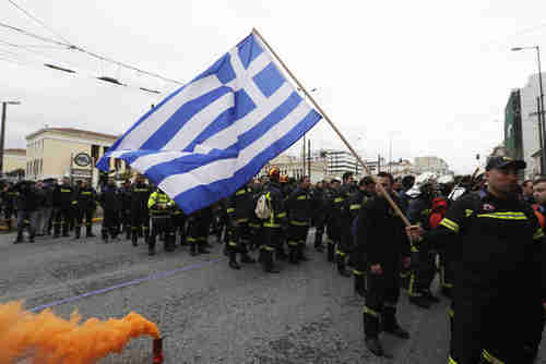 Hundreds of firefighters in uniform in Athens protest working conditions on Wednesday (AP)