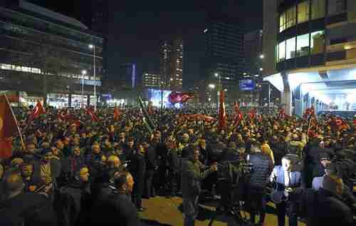 Demonstrators outside the Turkish consulate in Rotterdam on Saturday evening (Reuters)