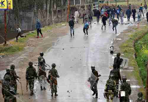 A group of youth pelt stones at Indian security forces in Budgam on Tuesday (PTI)