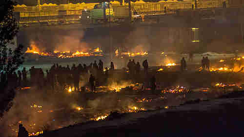 Grande-Synthe refugee camp in Dunkirk, France, burnt to the ground Monday night (Telegraph)