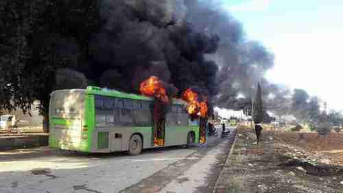 A bus burning during the attack.  The passengers were still in their seats as the bus burned. (ARA News)