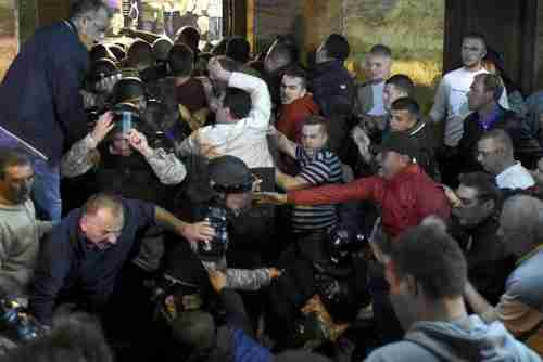 Protesters clash with police blocking the entrance to the parliament building in Skopje, Macedonia, on Thursday evening (AFP)