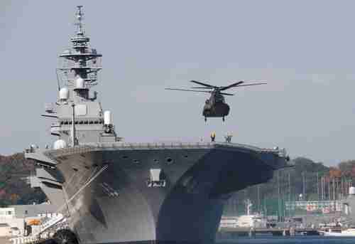 A helicopter lands on the decks of the JS Izumo (Reuters)