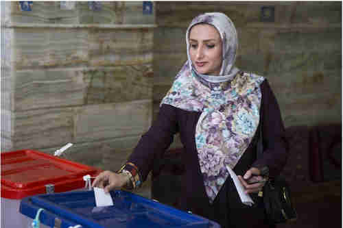 Young woman voting in Iran on Friday
