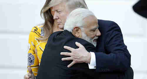 Narendra Modi and Donald Trump hugging during their meeting (AP)