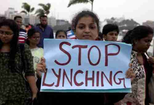 A protester in Hyderabad, India, on Wednesday holds up a sign saying 'Stop Lynching' (AP)