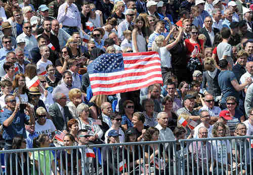 A large American flag-waving crowd greets Donald Trump in Warsaw Poland on Thursday