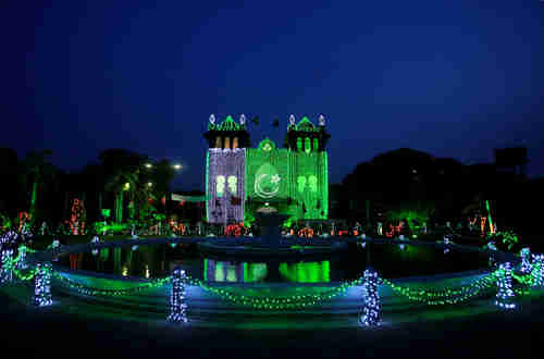 A government building in Lahore is illuminated in the colors of Pakistan's national flag in celebration of independence (Reuters)