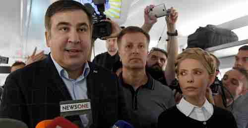 Mikhail Saakashvili (L) is joined by Ukraine's former prime minister Yulia Tymoshenko (R) and other supporters on Sunday after entering Ukraine from Poland (AFP)