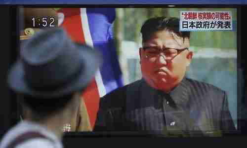 Kim Jong-un in a Japanese news broadcast being broadcast on an outdoor video screen in Tokyo. (AP)