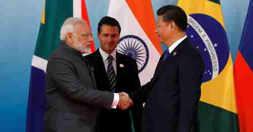 China's President Xi Jinping greets India's Prime Minister Narendra Modi and Mexico's President Enrique Peña Nieto at BRICS summit on Sept 5 in Xiamen, China, shortly after Doklam border agreement was reached (Reuters)