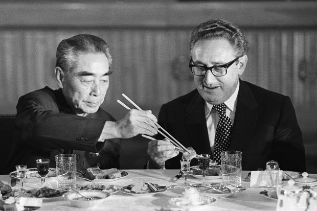 Henry Kissinger shares a meal with Chinese premier Zhou Enlai; Beijing, 1972