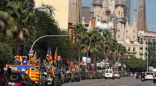 On Friday, hundreds of farmers drove tractors into Barcelona to support the referendum and to protect polling places (Reuters)