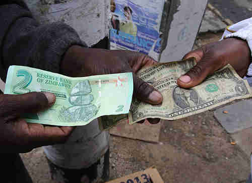 Zimbabwe bond note and US dollars (New Zimbabwean)