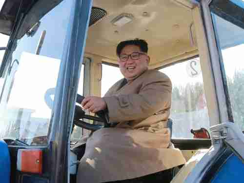 The gargantuan Kim Jong-un inspects a tractor factory last week (AFP)