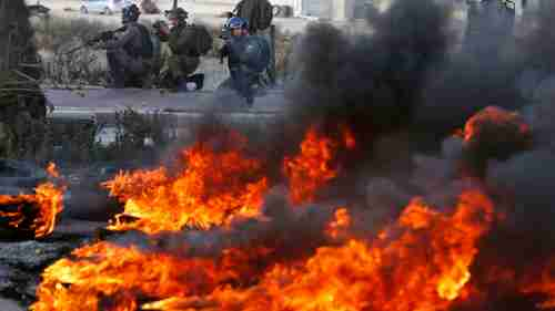 Israeli troops clash with Palestinian demonstrators in Ramallah on Thursday (Sky News)
