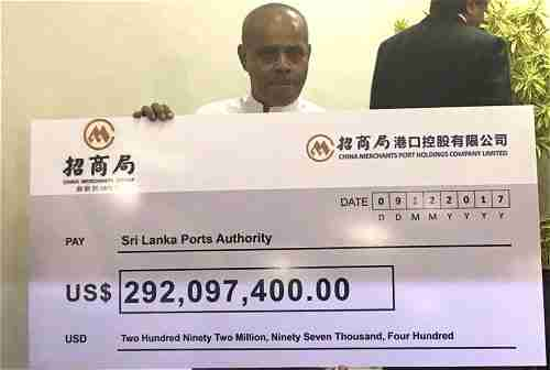 China gives Sri Lanka a check for $292,097,400.00 as the first payment for Hambantota port (Colombo Page)