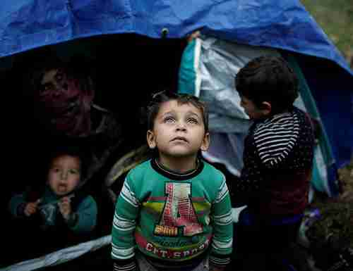 Child migrant in Greek refugee camp (AFP)