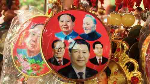 Chinese souvenir badge with pictures of Mao Zedong, Deng Xiaoping, Jiang Zemin, Xi Jinping, and Hu Jintao (AFP)