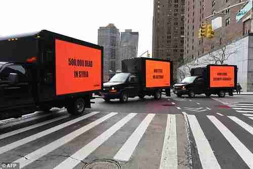 Inspired by the Oscar-nominated film 'Three Billboards Outside Ebbing, Missouri,' three billboards circle the United Nations on Thursday for three hours to demand action on Syria from the Security Council (AFP)