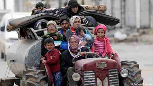 Syrians flee from airstrikes and shelling of village near Afrin (Reuters)
