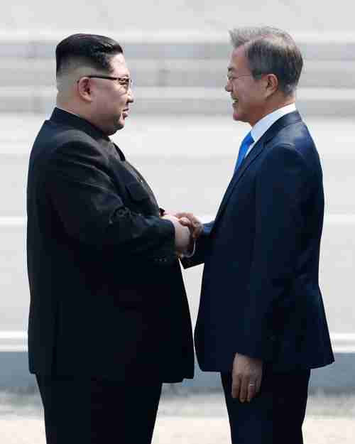 South Korean President Moon Jae-in and North Korean leader Kim Jong-un shake hands in front of Freedom House at Panmunjeom, Friday. (Korea Times)
