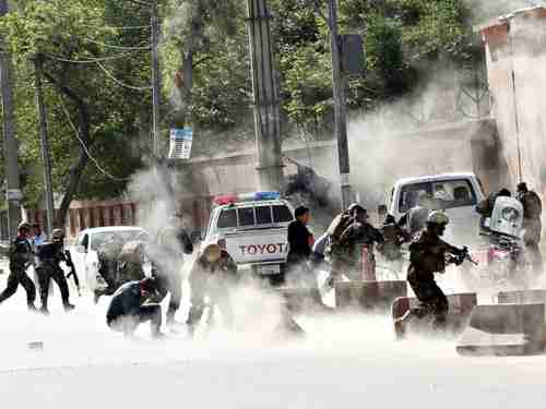 Security forces run from the second coordinated suicide attack bombing in Kabul on Monday (AP)