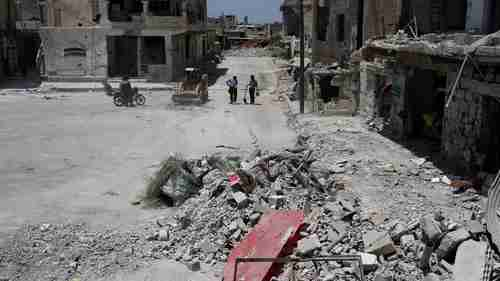 A bulldozer clears debris from the streets in Deraa, Syria July 25, 2017 (Reuters)