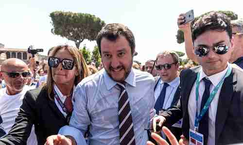 Italy's new interior minister Matteo Salvini (center) savors his victory