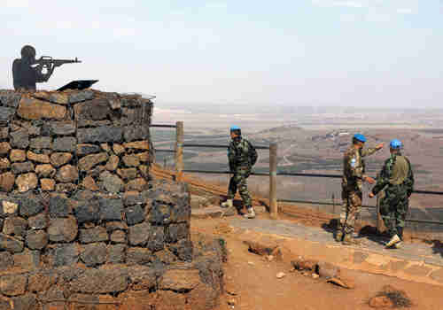 U.N. peacekeepers patrol Mount Bental, an observation post in the Golan Heights near the ceasefire line between Israel and Syria, October 23, 2017.  (Reuters)