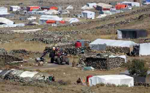 Displaced Syrians camp near border with Israel-controlled  Golan Heights (AFP)