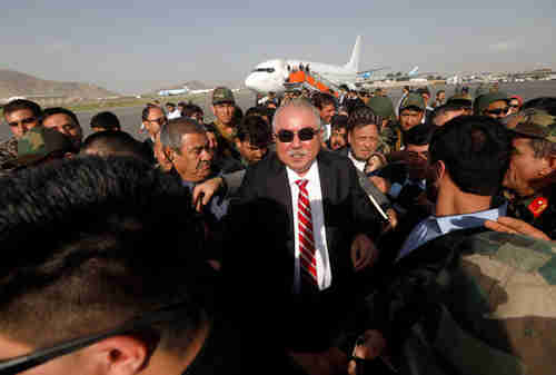 Gen. Abdul Rashid Dostum, Afghan vice president and Uzbek warlord, arrives in Kabul on Sunday, greeted by hundreds of supporters (Reuters)