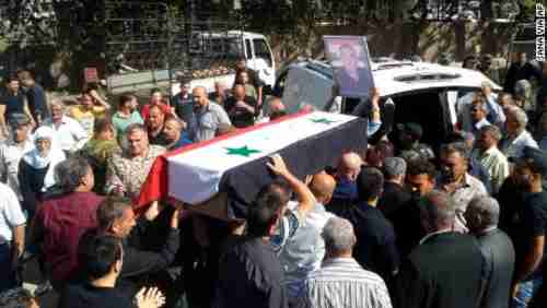 Mourners carry a coffin of one of Wednesday's victims (SANA)