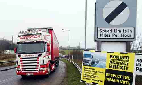 An anti-Brexit placard at the Ireland - Northern Ireland border crossing in Killeen (AFP)