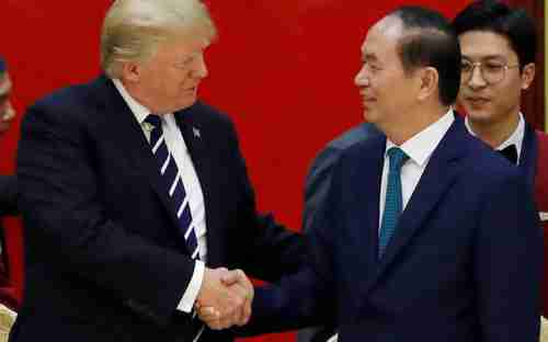 Donald Trump meets Vietnam's leader Tran Dai Quang in Hanoi last year (Reuters)