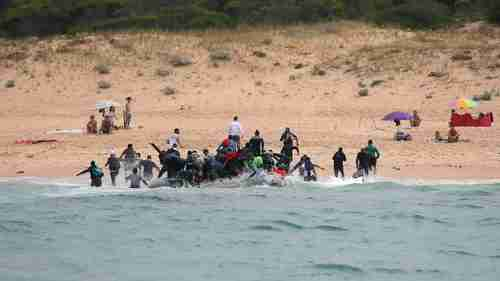 Migrants disembark at a beach in Tarifa, southern Spain, after crossing the Strait of Gibraltar (Spiegel)