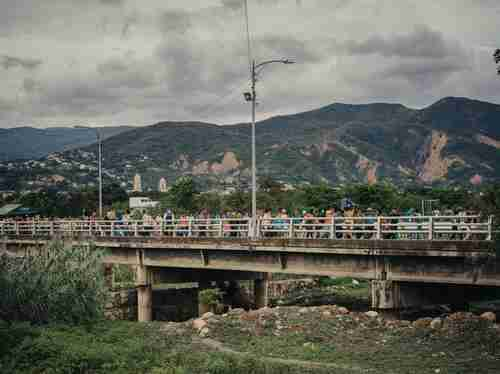 Venezuelans walk across Simón Bolívar bridge into Cúcuta, Colombia to flee violence from the Socialist government. (National Geographic)