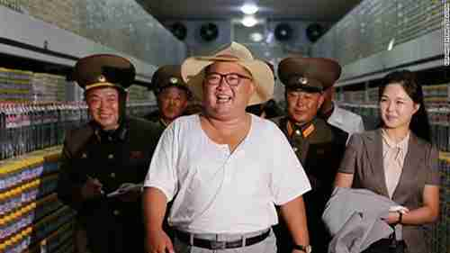 North Korea's child dictator Kim Jong-un in a tee shirt, frolicking with his wife Ri Sol-ju and his army generals