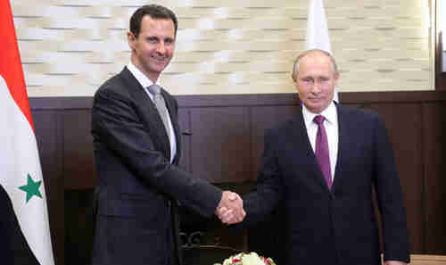 Bashar al-Assad and Vladimir Putin are demanding that the West pay $250 billion to rebuild Syria (Getty)
