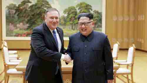 Mike Pompeo and Kim Jong-un shake hands prior to their May 9 meeting in Pyongyang (Reuters)