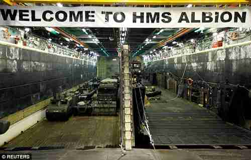 Military vehicles in the loading dock of the HMS Albion (Reuters)